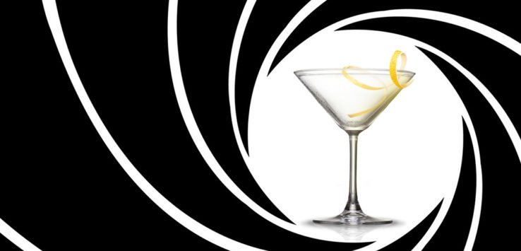 a martini glass with the james bond background